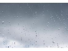 灰色透明玻璃上的水滴m88.com图片