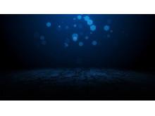 蓝色动态光斑背景商务PPT背景图片