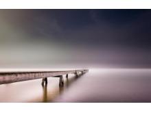 褐色背景大桥唯美PPT背景图片