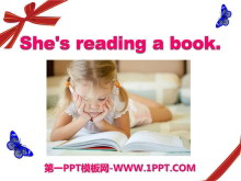 《She's reading a book》PPT课件3