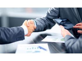 商务洽谈合作握手PPT背景图片