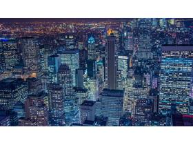 蓝色发达城市夜景PPT背景图片