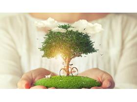 绿树小狗自行车环保主题PPT背景图片